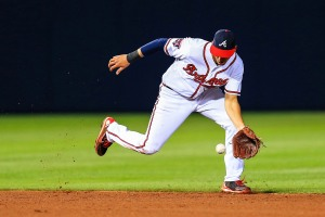Apr 21, 2014; Atlanta, GA, USA; Atlanta Braves shortstop Andrelton Simmons (19) fields a ground ball for an out in the fifth inning against the Miami Marlins at Turner Field. Mandatory Credit: Daniel Shirey-USA TODAY Sports
